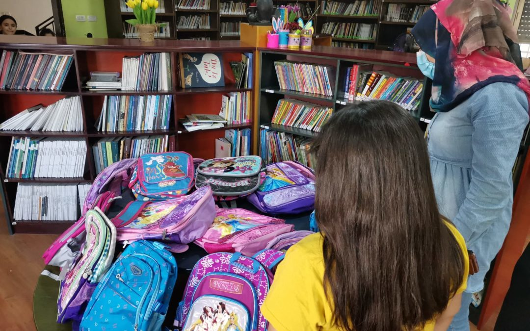 Alrowwad distributes school backpacks and supplies for children